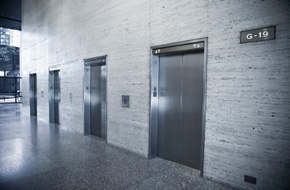 IBC 2009 requires at least one fire service access elevator in buildings with an occupied floor more than 120 feet above the lowest level of fire department vehicle access.